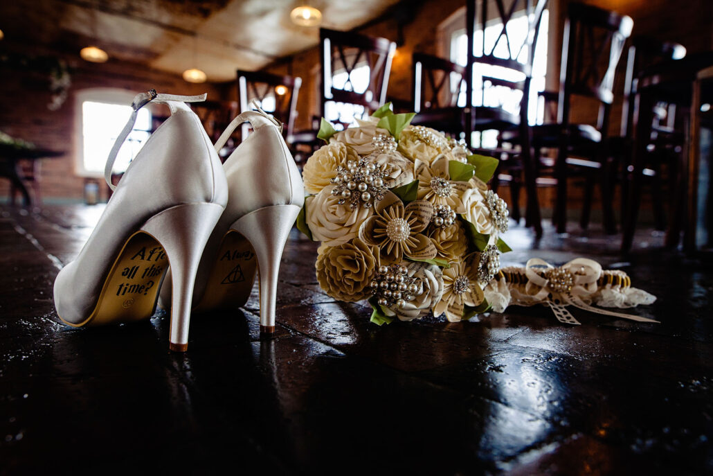 wedding shoes and paper flowers at The West Mill Derby