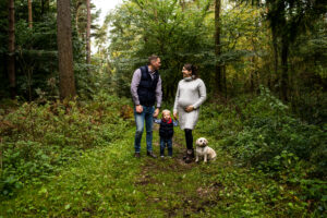 Mum, Dad, Son and dog walking in the woods